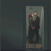 view of actors Rachel and Ben through a doorway into an empty room